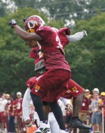 Cornerbacks DeAngelo Hall and David Amerson celebrate Hall's interception return for a touchdown. Photo by Jake Russell.