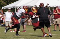 Offensive tackle Morgan Moses keeps linebacker Trent Murphy at bay during a blocking drill. Photo by Jake Russell.