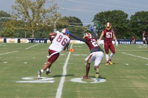 Jordan Reed makes a move upfield against Duke Ihenacho. (Photo by Jake Russell)