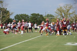 Josh Norman works on field goal blocking drills. (Photo by Jake Russell)