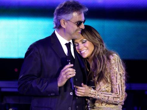 "Andrea Bocelli and Jennifer Lopez embrace after the duo performed their duet: ""Quizas Quizas Quizas."" (Photo property of the Associated Press)"