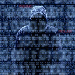 Silhouette of a hacker isloated on black with binary codes on background