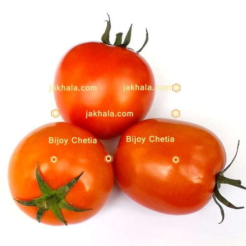 Three tomatoes are decorated