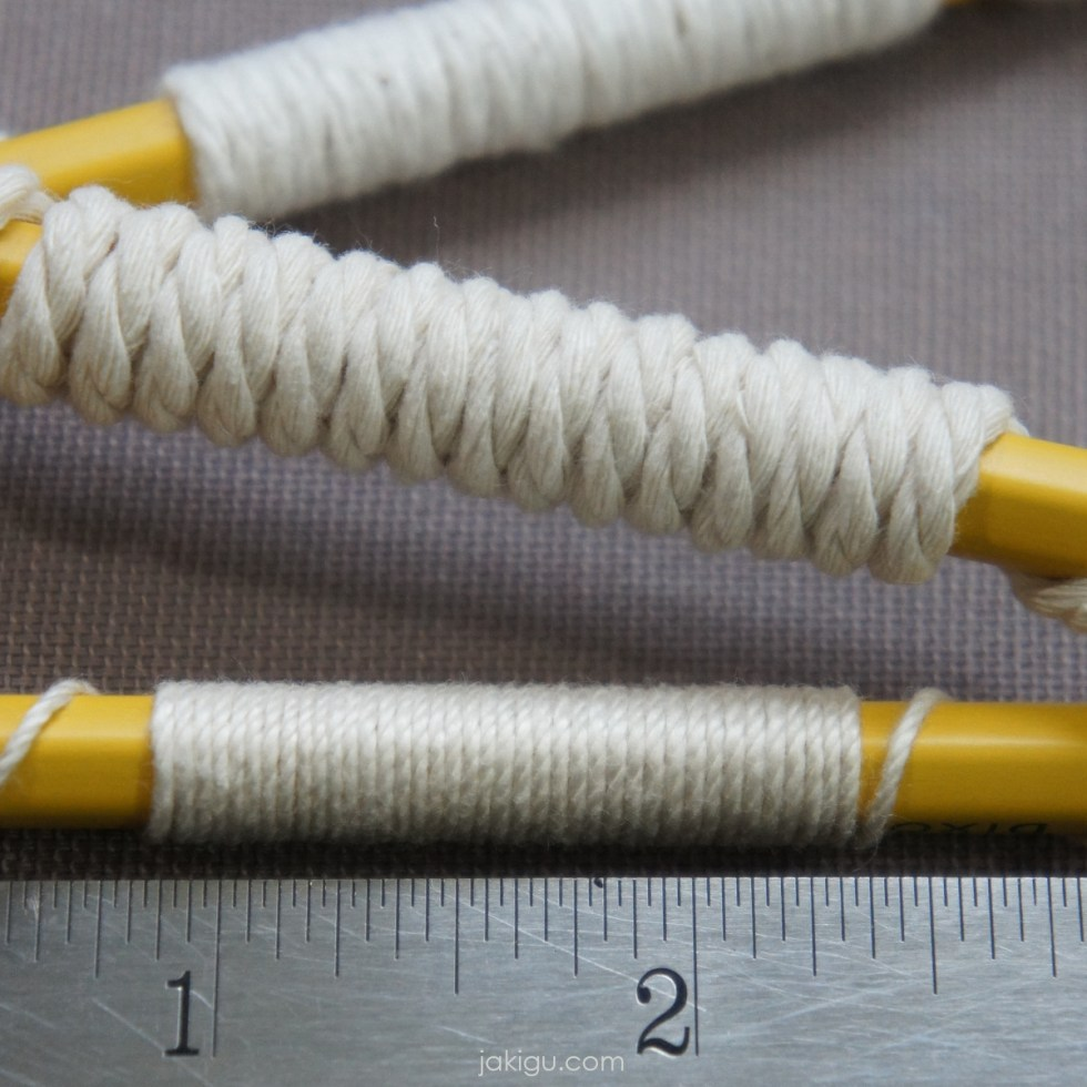 wraps per inch method tips | jakigu.com | three yellow pencils, each wrapped with white yarn of different thickness, with metal ruler in the foreground