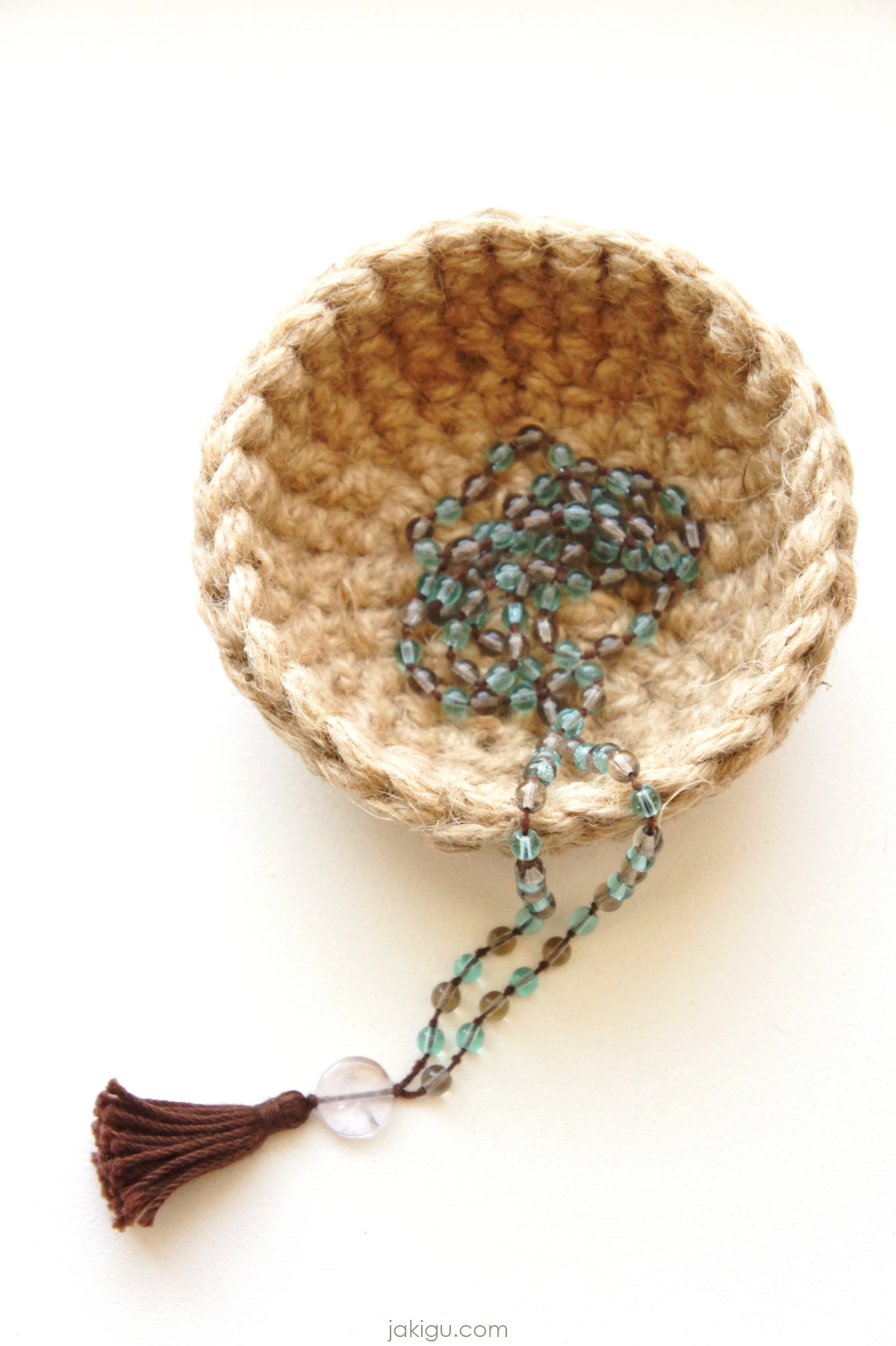 tiny crochet bowl with mala necklace