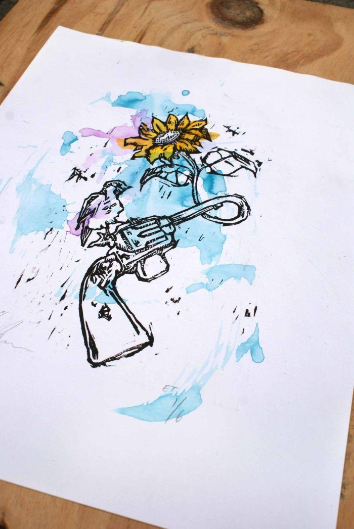 Udsnit af kunsttryk med pistol og blomst