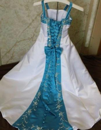 White miniature wedding dress with turquoise accents.