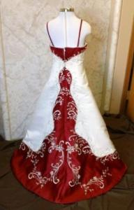bride and matching flower girl dresses, shown in ivory and apple red.