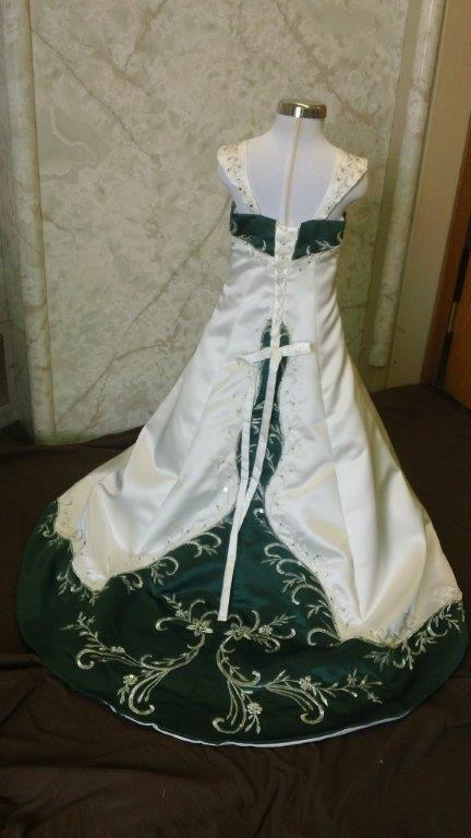 Ivory flower girl dress with green trimmed bodice, and sweep train, accented with crystal beaded embroidery.