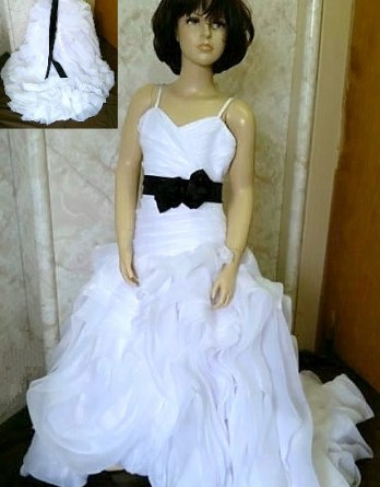 white trumpet flower girl dress with black sash