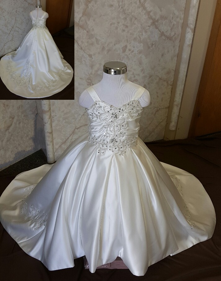 Who designs flower girl dresses to match your wedding dress?