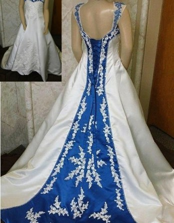 Ivory little brides dresses. Royal blue trimmed neckline, lace up back and chapel train with beaded lace applique.