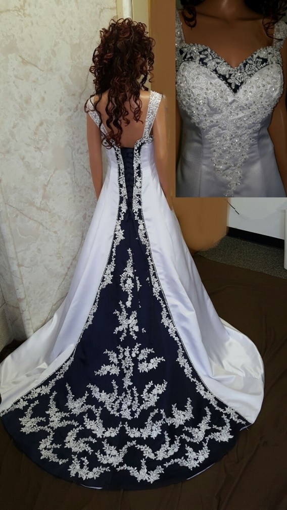 Navy blue and white wedding dress. Navy blue trimmed neckline, lace up back and chapel train with beaded lace applique.