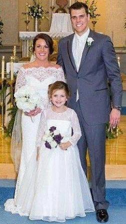 Long sleeve lace flower girl dress.