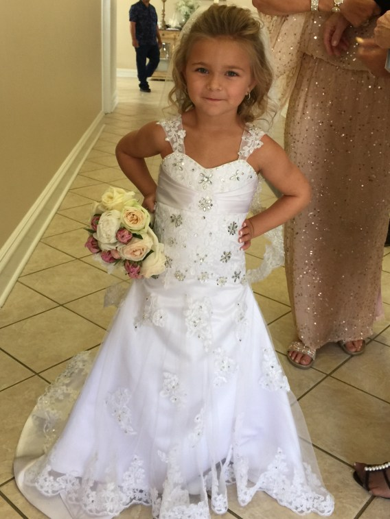 Wedding dress and matching lace and crystal flower girl dress