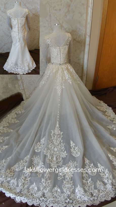 Long sleeve lace flower girl dress with elegant detachable train.