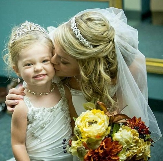 This little toddler flower girl is dressed to match the bride.
