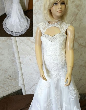 Designer mermaid flower girl dress with cutouts. It was created by Jaks, to perfectly match the brides gown.