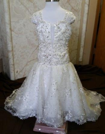 Fit and flare flower girls wedding dress with sweetheart neckline.