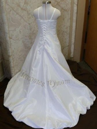 "Baby daughters wedding dress, train says ""Here comes my Mom""."