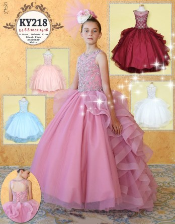 Girls ruffle pageant gown with horsetail trim.Tendrils of spiral ruffle tiers cover the back of this floor length dress completed with a beaded bodice.