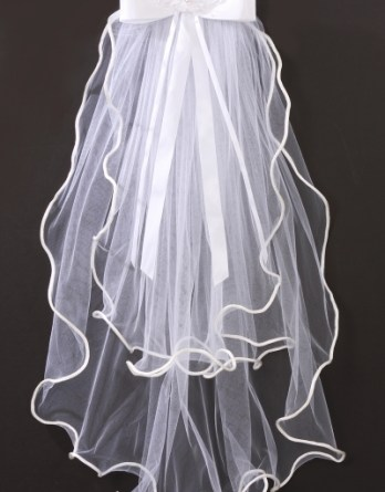 Flower girl veil with curled wire hem.