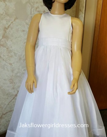 White sleeveless flower girl dresses with a sash rose on back in size 5,6,7,9 on sale for only $40.