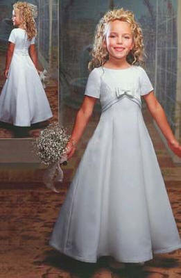 Long white short sleeve flower girl dress, an empire waist with a bow. On sale for $40.