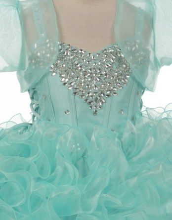 Aqua little girls ball gown. Jeweled heart shape bodice with ruffle ball gown skirt. Sheer organza bolero jacket.