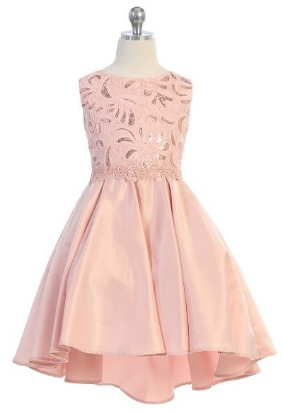 Girls formal blush dresses. Sleeveless dress with round neck, shiny pattern bodice, high low skirt with pleated back.