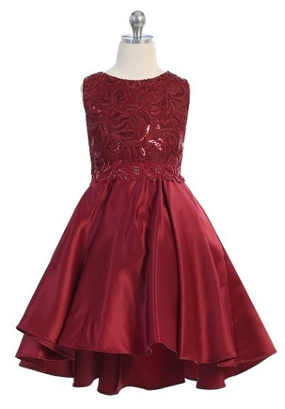 Girls formal burgundy dresses. Sleeveless dress with round neck, shiny pattern bodice, high low skirt with pleated back.