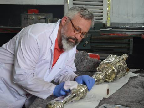 Canadian conservator Alexander Gabov puts the finishing touches on the 1753 mace.