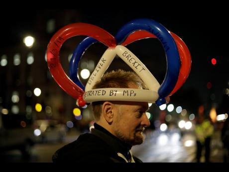 A pro-Brexit demonstrator protests during a rally outside the houses of Parliament in London, Thursday, October 31, 2019. The EU has allowed Britain to delay its Brexit departure from the bloc until January 31, 2020 enabling Britain to hold a general election on December 12, 2019.