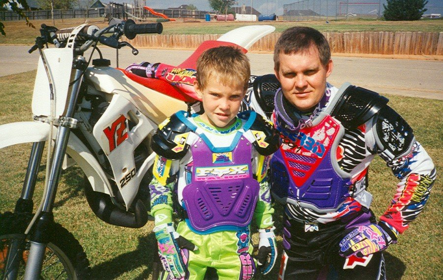 "My son Adam Pratt and I with my Yamaha YZ-250 motorcycle. He was riding a Yamaha PW-50 at the time. He upgraded to a KX-60 right before it was stolen at the same time as my YZ. Neon was the ""in"" thing in motocross at the time."