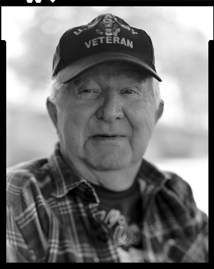 "Dick Summers had a stern look on his face as I was taking a portrait of him with my Toyo VRX-125 view camera on 4x5 film. I knew he was a long time heavy equipment operator and owner, so I asked him a simple question ""Caterpillar or John Deere?"". That brought this small smile to his face as he said quietly ""Caterpillar""."