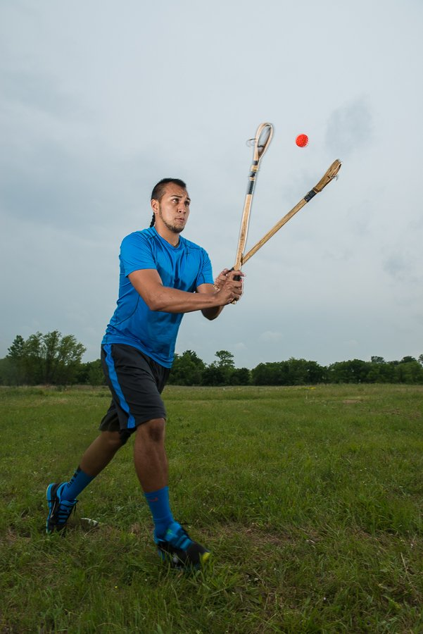 Billy Eagleroad catchs a ball mid-air using only his sticks.  Players cannot touch the ball with their hands or feet.