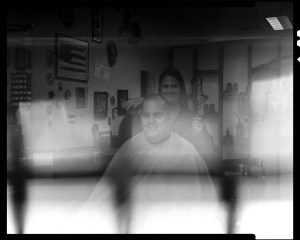 This shot of me getting a haircut from my barber did not turn out so swell. I have not yet figured out what caused the over-exposure of the lower half of the image. Shot with my Toyo 45a and a 150 lens on Ilford HP4 at 400 ISO.