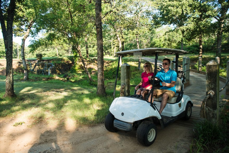 The cart paths wind through the trees at Lake Murray State Park golf course.