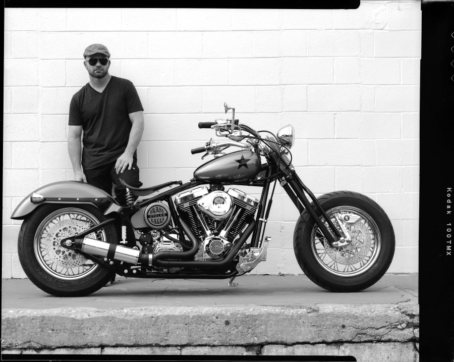 Dar Holdsworth, owner of Darwin Motorcycles and Brass Ball Choppers, with a custom bike he built that is being shipped to Dubai.
