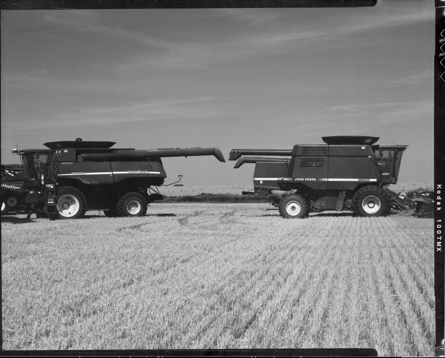 John Deere combines during wheat harvest in northern Oklahoma