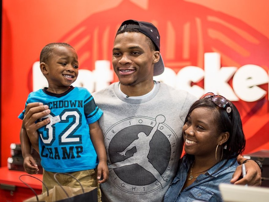 Russell Westbrook was happy to pose for pictures with adoring fans at his Nike/Air Jordan shoe rollout at the Quail Springs Mall Foot Locker store.