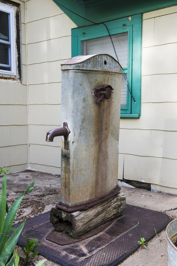 This old water pump was on the Plett homestead when Jennifer and Perry moved into the abandoned home in the early 1980's. It no longer functions. It used a bucket and pully system to hoist water from the cistern on the property.