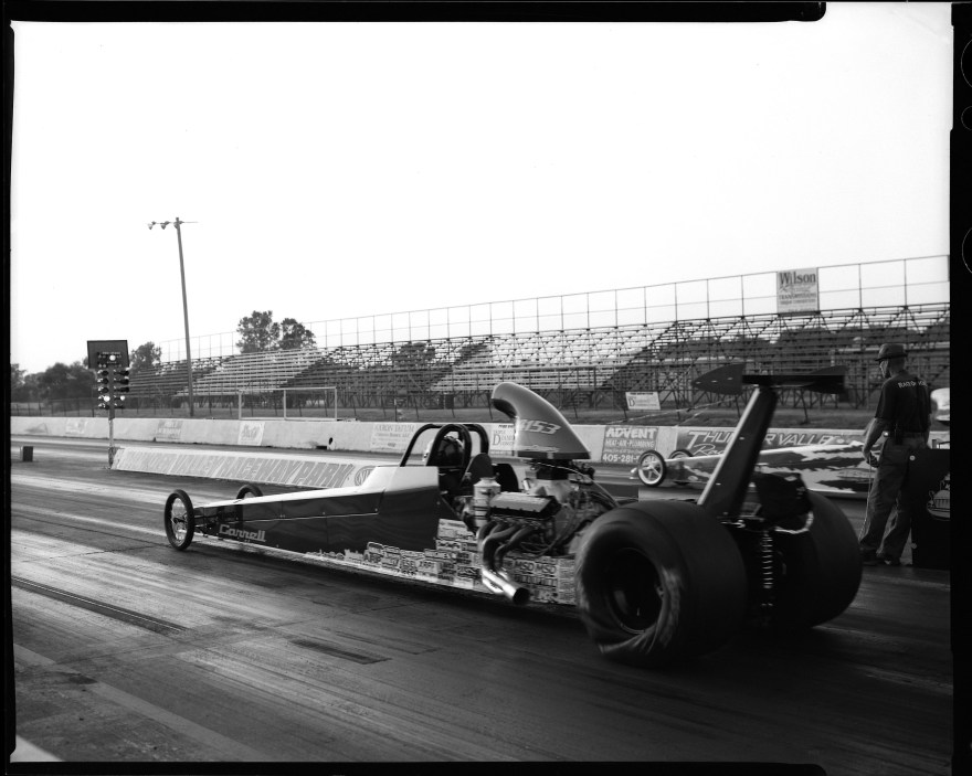 Alcohol rail dragster at Thunder Valley Raceway in Noble, Oklahoma. Shot with Toyo VRX-125 camera, Rodenstock 135 F5.6 lens on Ilford HP5 black and white film.
