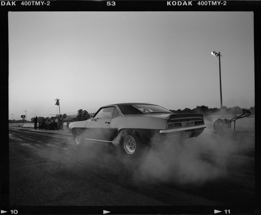 Chevy Camaro doing a burnout at the Thunder Valley Raceway drag strip. Shot with Pentax 67 on Kodak TMAX-400 film.