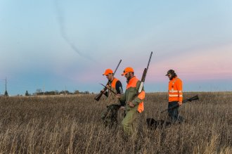 Vance Fielder and the two local hunters we met just an hour before walk back after retrieving a downed bird.