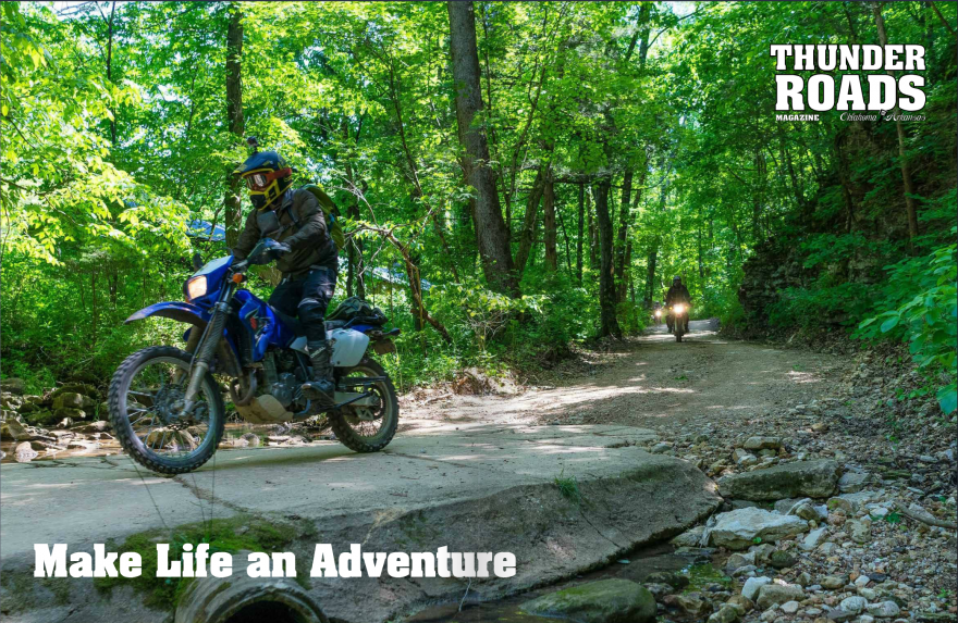 My son-in-law Dirk Mathews blasts along a dirt road on his blue Suzuki DRZ-400S motorcycle on this double truck opening spread for the Hillbilly Dual Sport story I wrote for Thunder Roads Magazine.