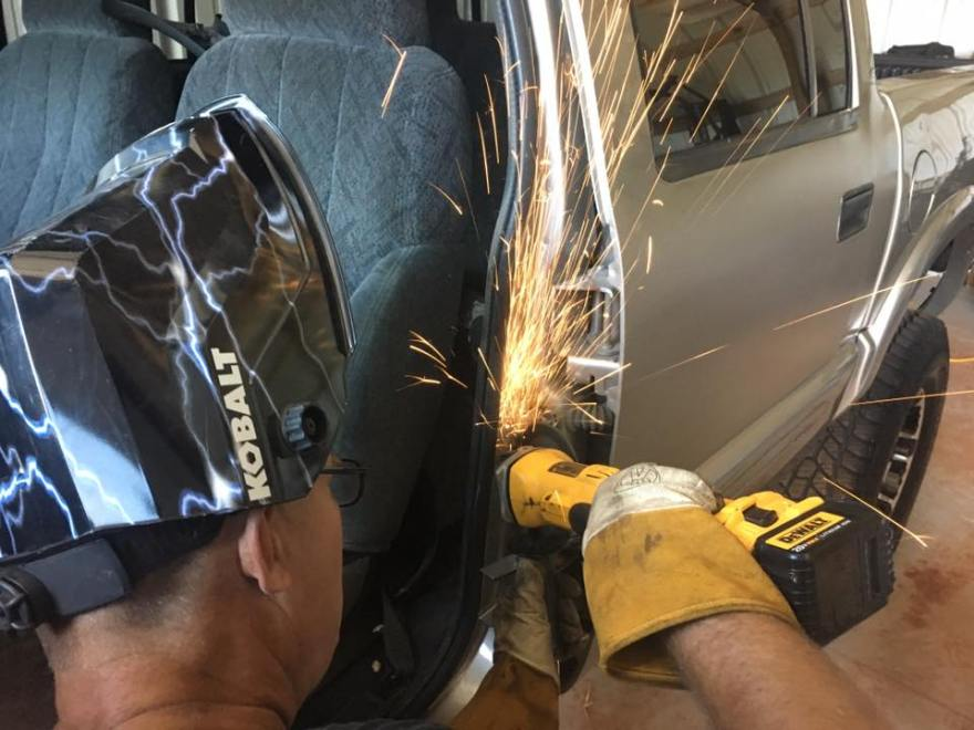 Grinding a weld smooth after TIG welding on a Ford Ranger pickup truck