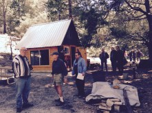 Rotary Club of Idyllwild members inspect the cook shed and campground area