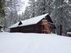 Trailfinders lodge with its blanket of winter snow