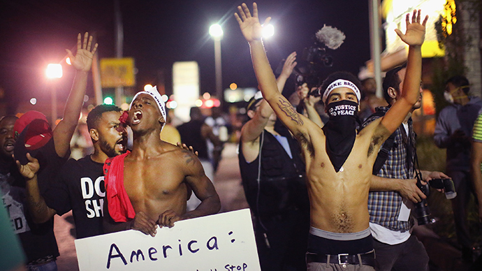 ferguson-protests-militarized-policing.si